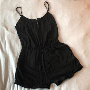 All black, spaghetti strap romper.